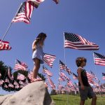 MALIBU, Sept. 11, 2018 (Xinhua) -- Children play among U.S. national flags erected to honor the victims of the September 11, 2001 attacks in New York, at the campus of Pepperdine University in Malibu, the United States, Sept. 10, 2018. (Xinhua/Zhao Hanrong/IANS) by .