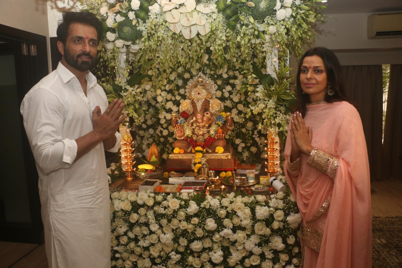 Mumbai: Actor Sonu Sood and his wife Sonali Sood offer prayers to Lord Ganesha on the occasion of Ganesh Chaturthi, in Mumbai on Sept 13, 2018. (Photo: IANS) by .