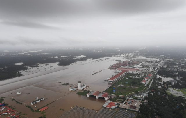 Kerala: An aerial view of the flood-hit areas of Kerala on Aug 18, 2018. Overflowing rivers and a series of landslides have caused the death of 180 people as of Saturday morning, with over three lakh people forced to move to some 2,000 relief camps. The disaster has triggered an unprecedented rescue and relief operation led by the Army, the Air Force and the Navy along with teams of National Disaster Response Force involving about 1,300 personnel and 435 boats. Prime Minister Narendra Modi on Saturday announced Rs 500 crore financial assistance for flood-ravaged Kerala. (Photo: IANS/PIB) by .