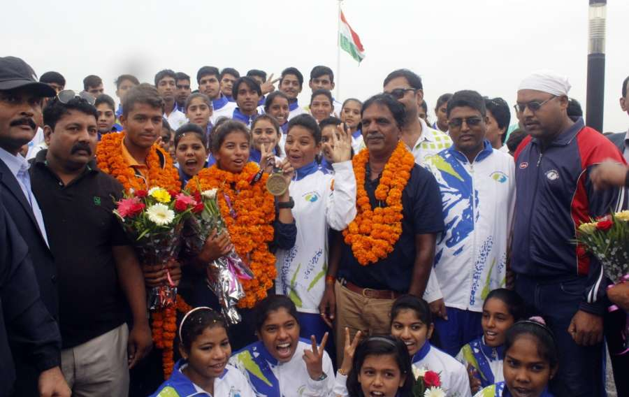 Bhopal: Harshita Tomar who won bronze in the Open Laser 4.7 category of Asian Games 2018 being accorded a grand welcome at Raja Bhoj Airport in Bhopal on Sept 2, 2018. (Photo: IANS) by .