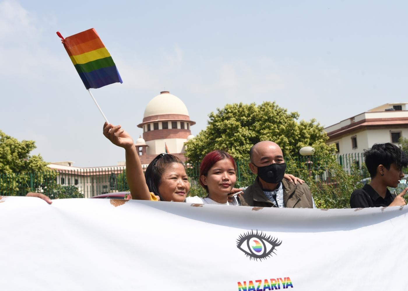 """New Delhi: LGBTIQ (lesbian, gay, bisexual, transgender/transsexual, intersex and queer/questioning) supporters celebrate after the Supreme Court in a landmark decision decriminalised homosexuality by declaring Section 377, the penal provision which criminalised gay sex, as """"manifestly arbitrary""""; in New Delhi on Sept 6, 2018. (Photo: IANS) by ."""