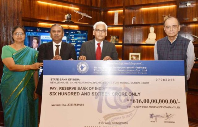 New Delhi: Union Finance and Corporate Affairs Minister Arun Jaitley being presented a dividend cheque by the CMDs (Joint Charge), New India Assurance Company Ltd. Director and General Manager Hemant G. Rokade; Director, General Manager and Financial Advisor C. Narambunathan, in New Delhi on Sept 4, 2018. (Photo: IANS/PIB) by .