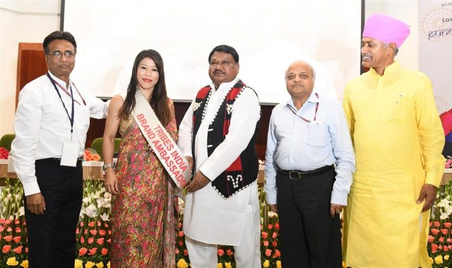 New Delhi: Union Tribal Affairs Minister Jual Oram launches World Boxing Champion Mary Kom as Brand Ambassador of Tribes India during a programme, in New Delhi on Sept 27, 2018. Also seen Tribal Cooperative Marketing Development Federation of India (TRIFED) Chairman Ramesh Chand Meena and Ministry of Tribal Affairs Secretary Deepak Khandekar. (Photo: IANS/PIB) by .