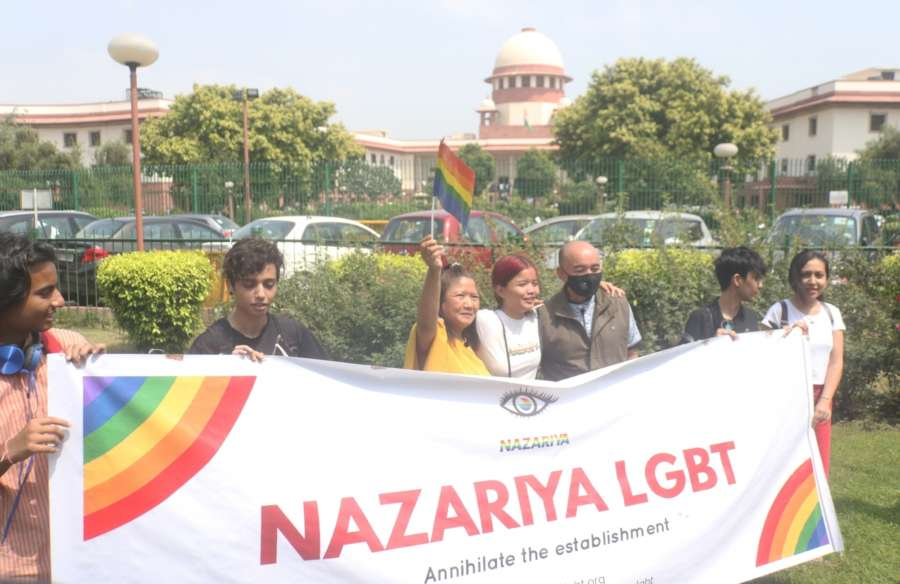"New Delhi: LGBTIQ (lesbian, gay, bisexual, transgender/transsexual, intersex and queer/questioning) supporters celebrate after the Supreme Court in a landmark decision decriminalised homosexuality by declaring Section 377, the penal provision which criminalised gay sex, as ""manifestly arbitrary""; in New Delhi on Sept 6, 2018. (Photo: IANS) by ."