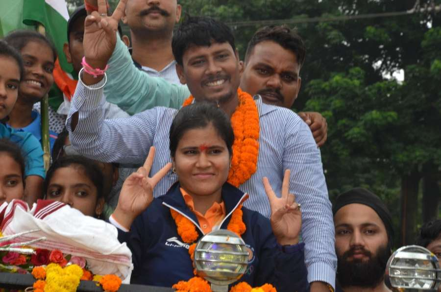 Ranchi: Indian archer Madhumita accorded warm welcome on her arrival in Ranchi on Sept 1, 2018. Madhumita clinched the silver medal in Compound Women's Team category at the ongoing 18th Asian games in Jakarta, Indonesia. (Photo: IANS) by .