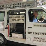 69-year-old Alagarathanam Natarajan in his water van in Delhi. by .