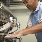 "The ""Takumi"" or senior architect Toshio Saito is seen at work at Canon's Utsunomiya facility. by ."
