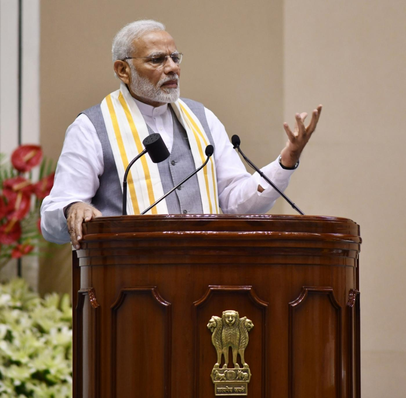 """New Delhi: Prime Minister Narendra Modi addresses at the launch of """"Moving On... Moving Forward: A Year In Office"""" - a book marking the completion of Naidu's one year as the Vice President and the Rajya Sabha Chairman; in New Delhi on Sept 2, 2018. (Photo: IANS/PIB) by ."""