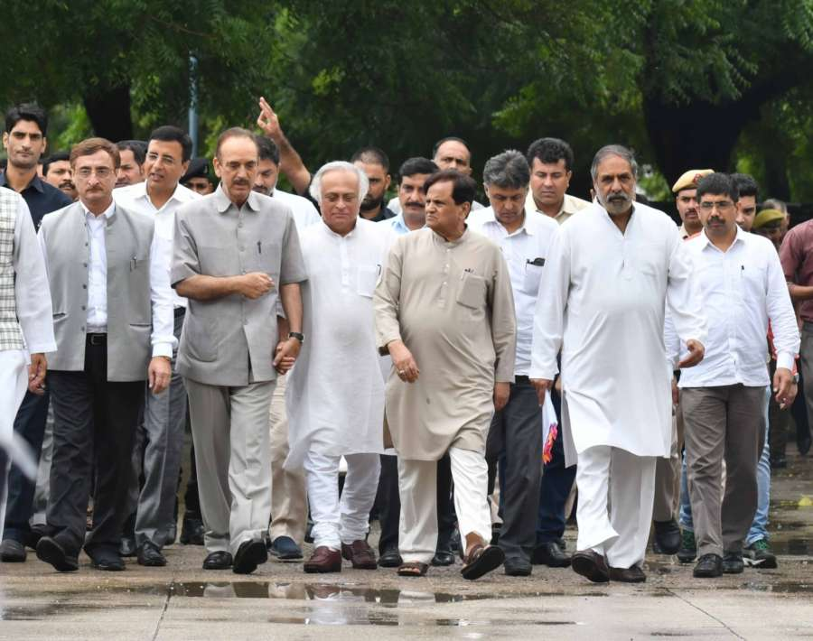 """New Delhi: A Congress delegation led by Ghulam Nabi Azad, Jairam Ramesh, Shakeel Ahmad and Anand Sharma arrive at CVC to submit a memorandum asserting that the deal announced by Prime Minister Narendra Modi was at an """"escalated price of about 300 per cent"""" and done in violation of the Defence Procurement Policy (DPP) in New Delhi on Sept 24, 2018. (Photo: IANS) by ."""
