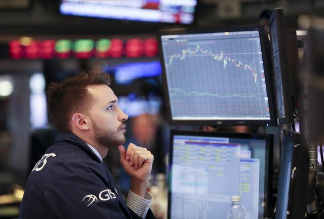 NEW YORK, Feb. 5, 2018 (Xinhua) -- A trader works at the New York Stock Exchange in New York, the United States, on Feb. 5, 2018. U.S. stocks closed sharply lower on Monday, with the Dow plummeting 4.60 percent, as the market took a heavy hit from panic sales. (Xinhua/Wang Ying/IANS) by .