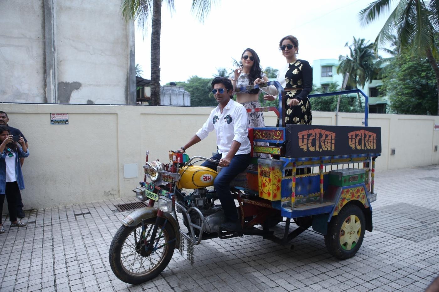 Mumbai: Actors Sunil Grover, Sanya Malhotra and Radhika Madan at the song launch of film