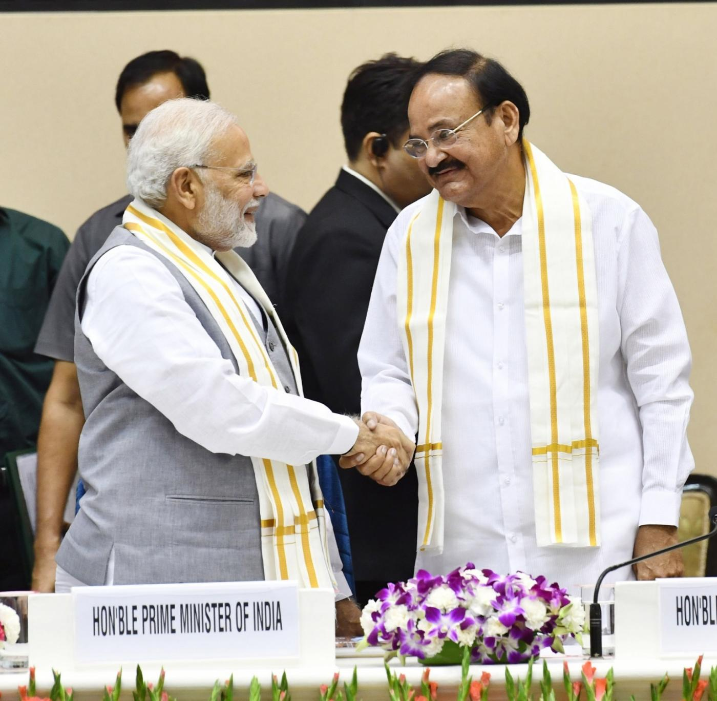 """New Delhi: Prime Minister Narendra Modi and Vice President and Rajya Sabha Chairman M. Venkaiah Naidu at the launch of """"Moving On... Moving Forward: A Year In Office"""" - a book marking the completion of Naidu's one year as the Vice President and the Rajya Sabha Chairman; in New Delhi on Sept 2, 2018. (Photo: IANS/PIB) by ."""