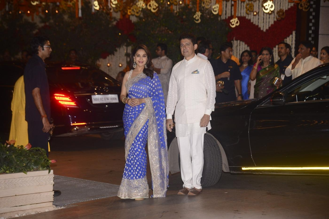 Mumbai: Actress Madhuri Dixit Nene along with her husband Sriram Madhav Nene arrive at Reliance Industries Chairman and MD Mukesh Ambani's residence to celebrate Ganesh Chaturthi in Mumbai on Sept 13, 2018. (Photo: IANS) by .