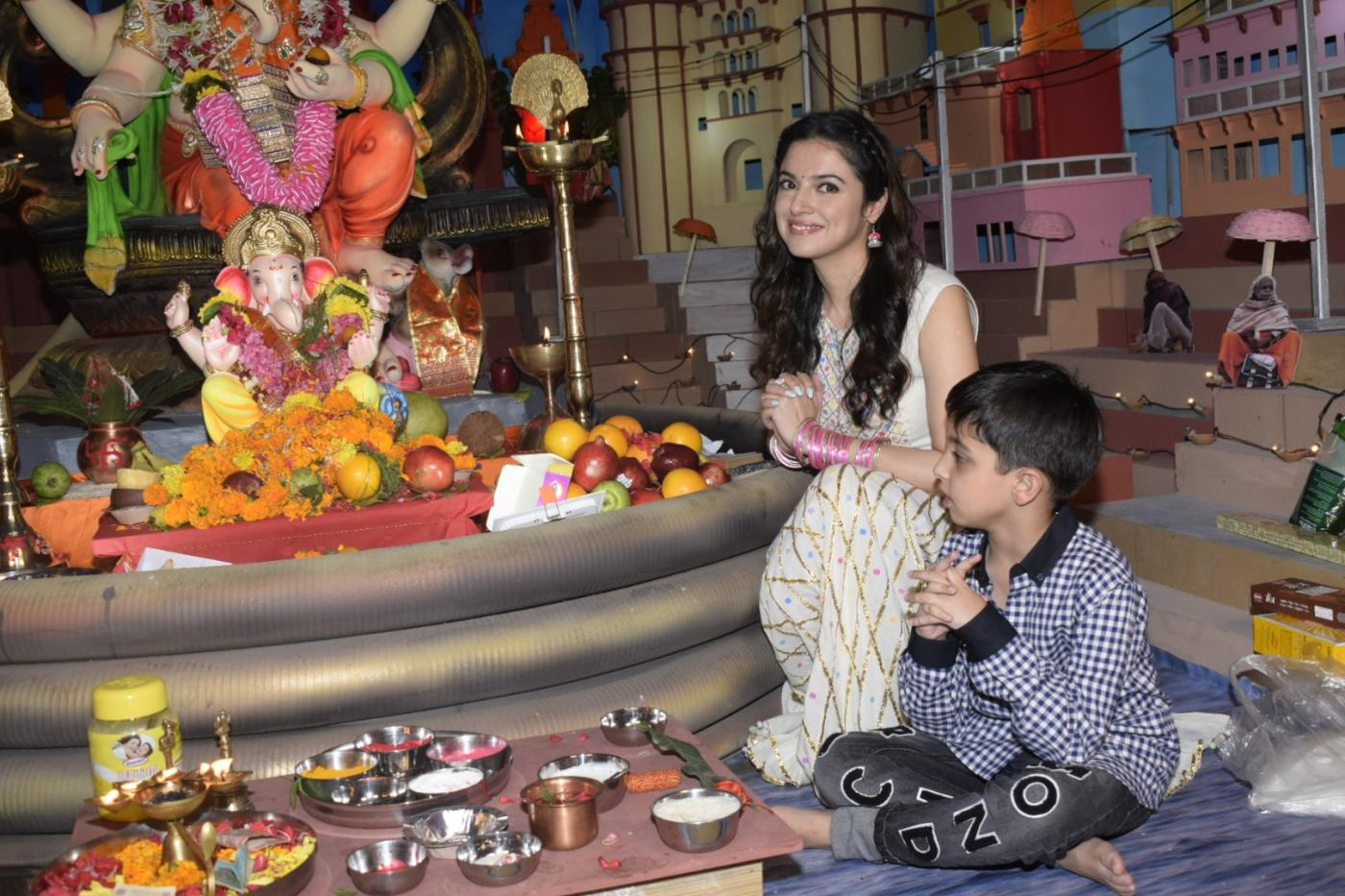"Mumbai: Actress-director Divya Khosla Kumar along with her son Ruhaan Kumar perform rituals on the occasion of ""Ganesh Chaturthi"" at T-Series office in Mumbai on Sept 13, 2018. (Photo: IANS) by ."