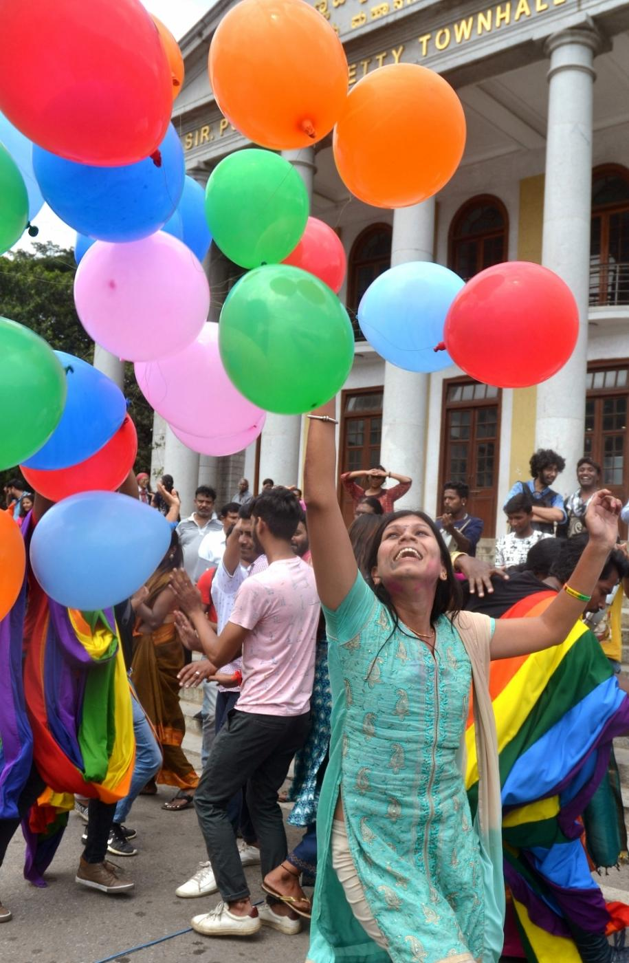 """Bengaluru: LGBTIQ (lesbian, gay, bisexual, transgender/transsexual, intersex and queer/questioning) supporters celebrate after the Supreme Court in a landmark decision decriminalised homosexuality by declaring Section 377, the penal provision which criminalised gay sex, as """"manifestly arbitrary""""; in Bengaluru on Sept 6, 2018. (Photo: IANS) by ."""