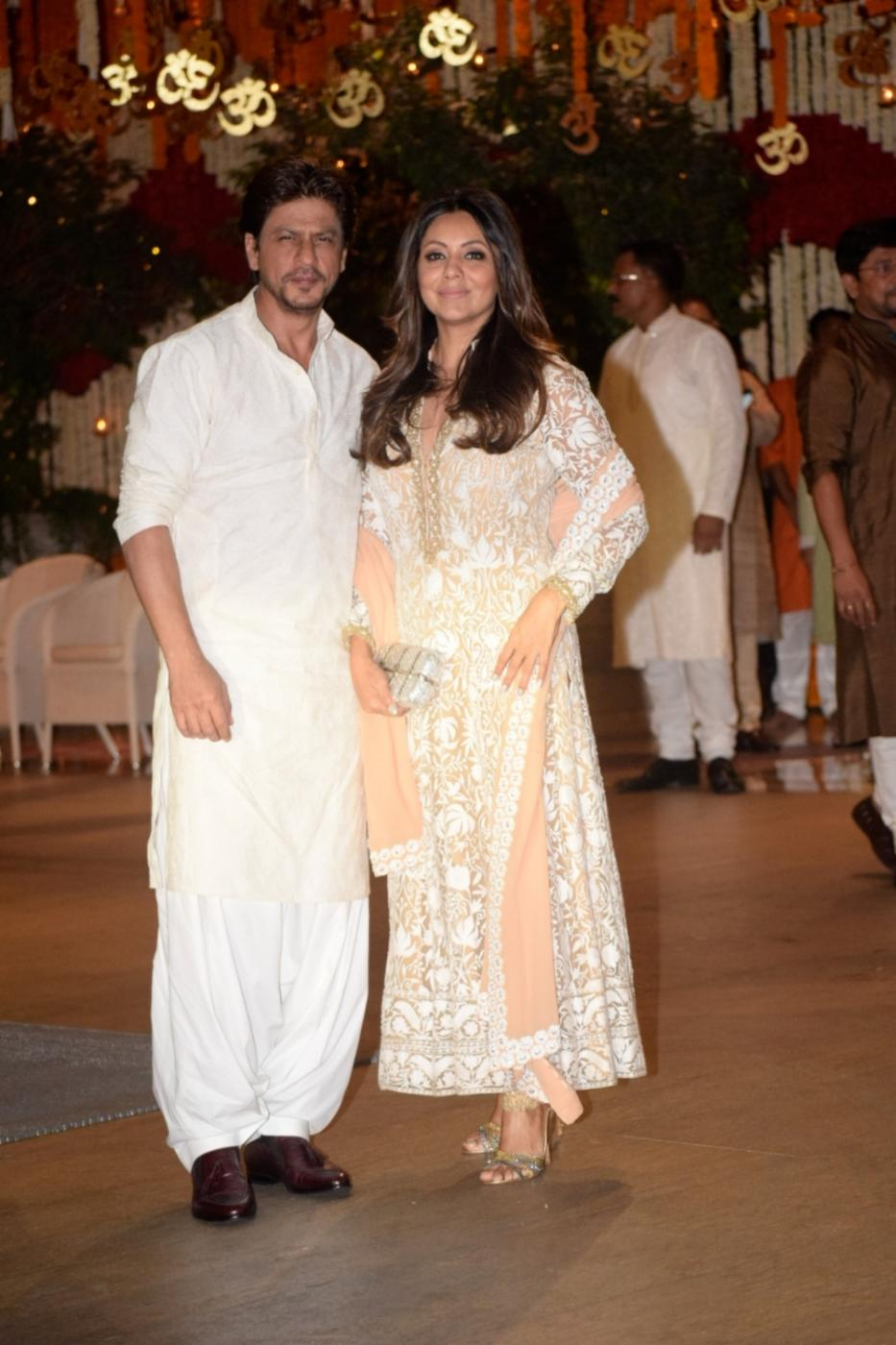 Mumbai: Actor Shah Rukh Khan with his wife Gauri Khan arrives at Reliance Industries Chairman and MD Mukesh Ambani's residence to celebrate Ganesh Chaturthi in Mumbai on Sept 13, 2018. (Photo: IANS) by .