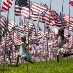 MALIBU, Sept. 11, 2018 (Xinhua) -- Children run among U.S. national flags erected to honor the victims of the September 11, 2001 attacks in New York, at the campus of Pepperdine University in Malibu, the United States, Sept. 10, 2018. (Xinhua/Zhao Hanrong/IANS) by .