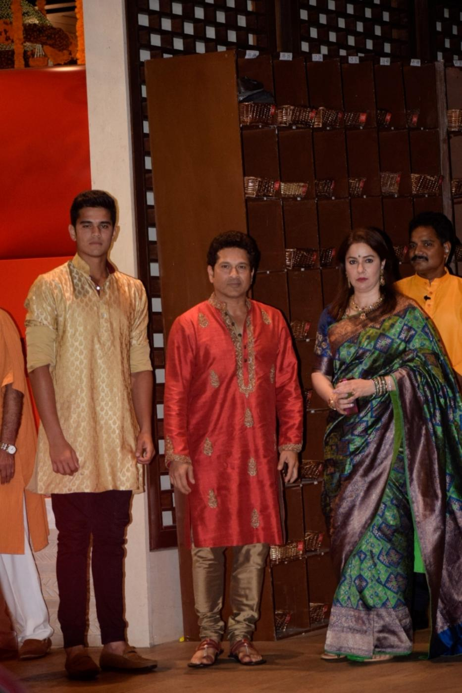 Mumbai: Former cricketer Sachin Tendulkar along with his wife Anjali Tendulkar and son Arjun Tendulkar at Reliance Industries Chairman and MD Mukesh Ambani's residence to celebrate Ganesh Chaturthi in Mumbai on Sept 13, 2018. (Photo: IANS) by .