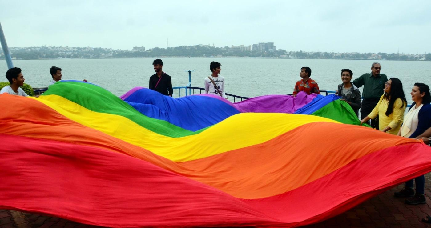 """Bhopal: LGBTIQ (lesbian, gay, bisexual, transgender/transsexual, intersex and queer/questioning) supporters celebrate after the Supreme Court in a landmark decision decriminalised homosexuality by declaring Section 377, the penal provision which criminalised gay sex, as """"manifestly arbitrary""""; in Bhopal on Sept 6, 2018. (Photo: IANS) by ."""