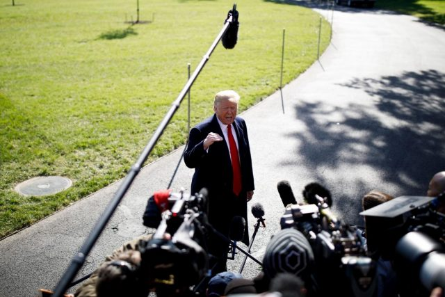 WASHINGTON, Oct. 22, 2018 (Xinhua) -- U.S. President Donald Trump speaks to reporters before departing from the White House in Washington D.C., the United States, on Oct. 22, 2018. Donald Trump said on Monday that his country will begin cutting off or reducing aid to three countries in Central America, citing migrant caravan heading to the U.S. border. (Xinhua/Ting Shen/IANS) by .