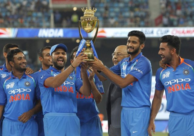 Dubai: Team India pose with the trophy after winning the Asia Cup 2018 final against Bangladesh at Dubai International Cricket Stadium in Dubai, UAE on Sept 28, 2018. (Photo: Surjeet Yadav/IANS) by .
