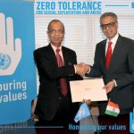 """The United Nations Under-Secretary-General for Field Operations, Atul Khare, left, receives India's contribution of $300,000 from India's Permanent Representative Syed Akbaruddin. The contribution is for the UN's """"Pipeline to Peacekeeping Command Programme."""" (Photo: Indian Mission/IANS) by ."""