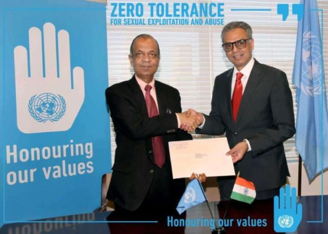 The United Nations Under-Secretary-General for Field Operations, Atul Khare, left, receives India's contribution of $300,000 from India's Permanent Representative Syed Akbaruddin. The contribution is for the UN's