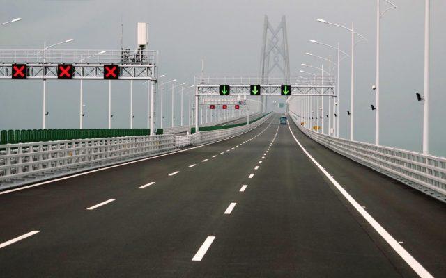 HONG KONG, Oct. 24, 2018 (Xinhua) -- Cars run on the Hong Kong-Zhuhai-Macao Bridge, Oct. 24, 2018. The Hong Kong-Zhuhai-Macao bridge, the world's longest cross-sea bridge, opened to public traffic at 9 a.m. Wednesday. (Xinhua/Wang Shen/IANS) by .