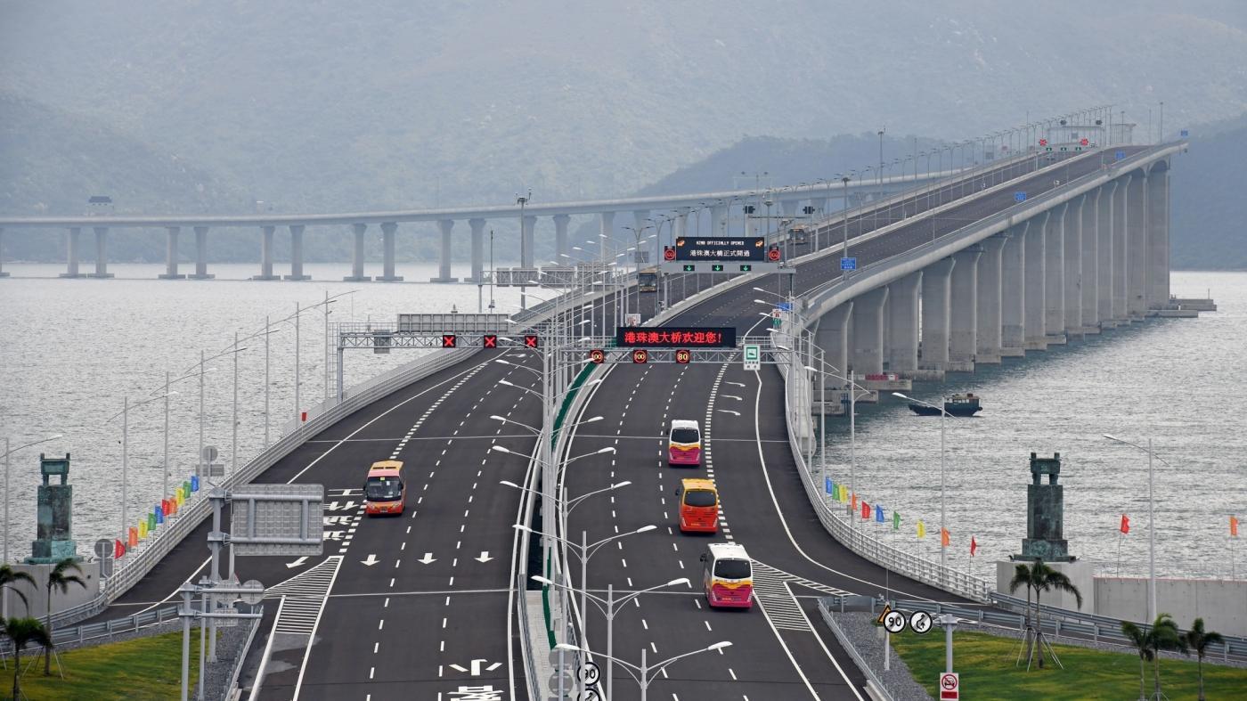 ZHUHAI, Oct. 24, 2018 (Xinhua) -- Cars run on the Hong Kong-Zhuhai-Macao Bridge, Oct. 24, 2018. The Hong Kong-Zhuhai-Macao bridge, the world's longest cross-sea bridge, opened to public traffic at 9 a.m. Wednesday. (Xinhua/Liang Xu/IANS) by .