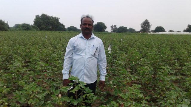 Farmer Ghule in front of the Automatic Irrigation Switch (AIS) installed at his farm. (Image: Nitin Jugran Bahuguna) by .