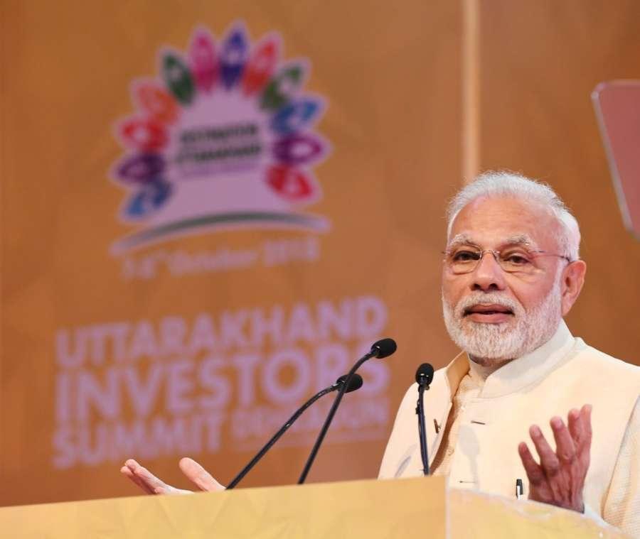Dehradun: Prime Minister Narendra Modi addresses at the Uttarakhand Investors Summit 2018 in Dehradun, Uttarakhand on Oct 7, 2018. (Photo: IANS/PIB) by .