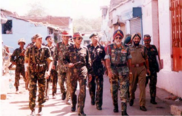 Army Commander Lt Gen G.S. Sihota (right) visits a troubled area to take stock of the situation, after the Godhra riots in 2002. (Photo Courtesy: Konark Publishers) by .