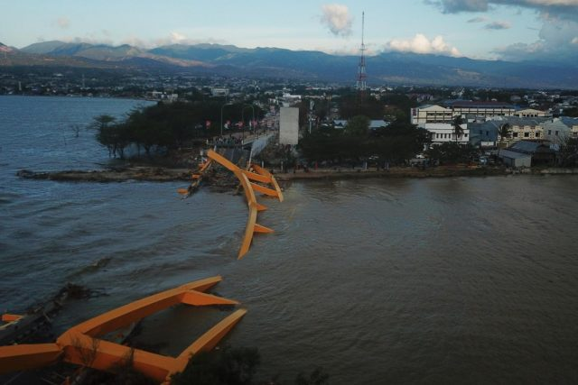 PALU, Oct. 8, 2018 (Xinhua) -- Photo taken on Oct. 8, 2018 shows the aerial view of a collapsed bridge after the earthquake and tsunami in Palu, Central Sulawesi, Indonesia. Death toll from multiple powerful quakes and an ensuing tsunami striking Central Sulawesi province of Indonesia on September 28 jumped to 1,948 on Monday and more than 5,000 others went missing, according to a disaster agency official here. (Xinhua/Wang Shen/IANS) by .