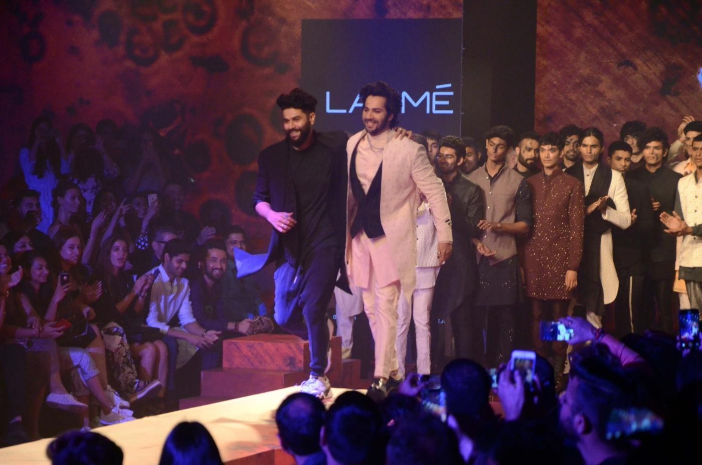 Mumbai: Actor Varun Dhawan with fashion designer Kunal Rawal at the Lakme Fashion Week Winter/Festive 2018, in Mumbai on Aug 25, 2018. (Photo: IANS) by .