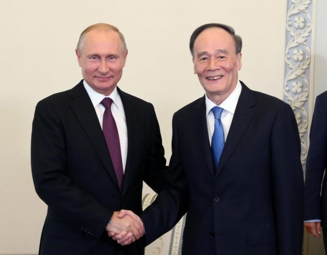 ST. PETERSBURG, May 24, 2018 (Xinhua) -- Chinese Vice President Wang Qishan meets with Russian President Vladimir Putin, in Russia's St. Petersburg, May 24, 2018. (Xinhua/Yao Dawei/IANS) by .