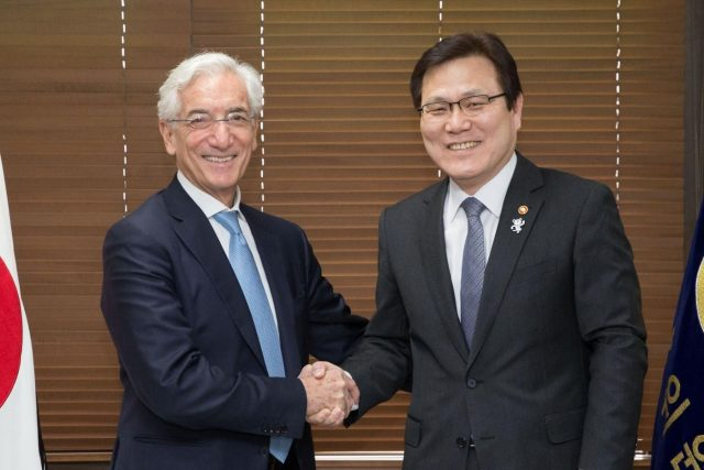 Seoul: Financial Services Commission (FSC) Chairman Choi Jong-ku (R) shakes hands with Ronald Cohen, chairman of the Global Social Impact Investment Steering Group (GSG), during their meeting in Seoul on Feb. 22, 2018, in this photo provided by the FSC.(Yonhap/IANS) by .