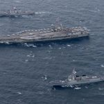 The USS Ronald Reagan aircraft carrier (C) conducts a drill with South Korean and U.S. warships in the East Sea on Oct. 18, 2017, in this photo provided by the U.S. Navy. (Yonhap/IANS) by .