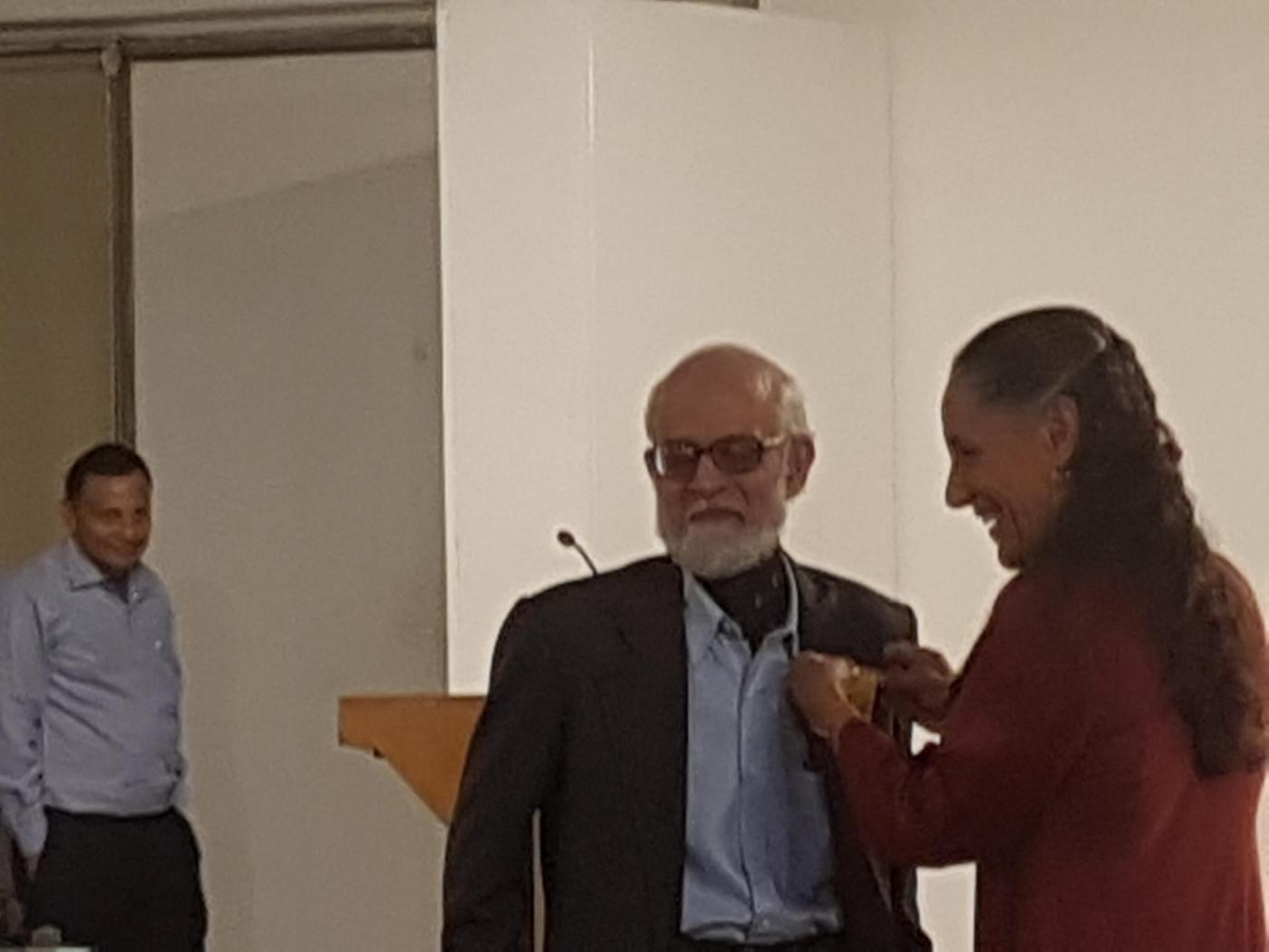 New Delhi: Mexican ambassador to India Melba Pria presents an award to Prof. Shyama Prasad Ganguly during the book launch and seminar sessions of