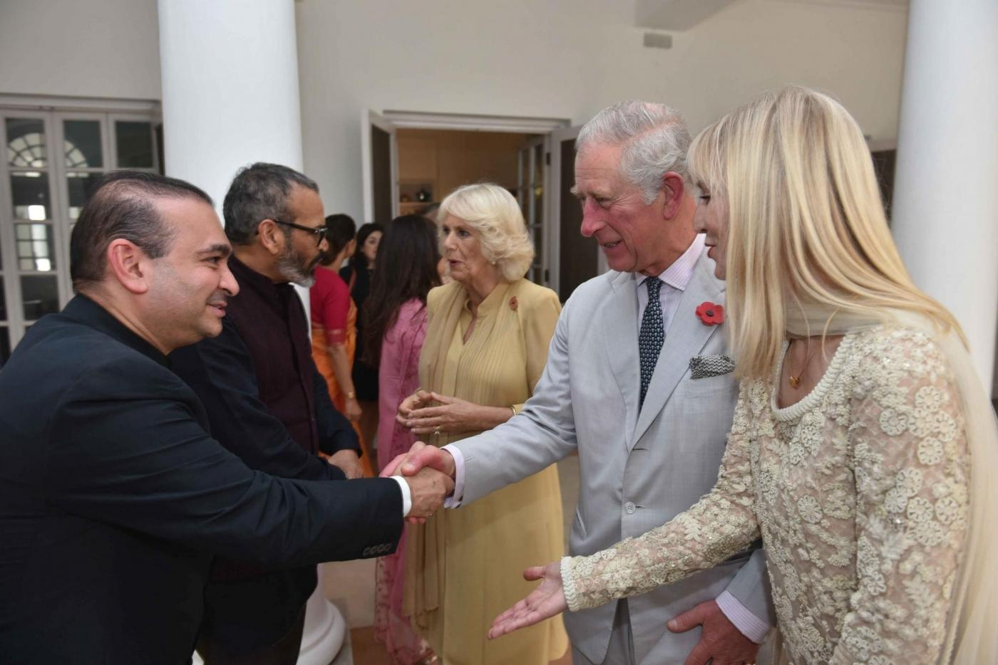Billionaire diamond trader Nirav Modi (R) shakes hands with TRH Charles, Prince of Wales and Camilla, Duchess of Cornwall. (File Photo: IANS) by .
