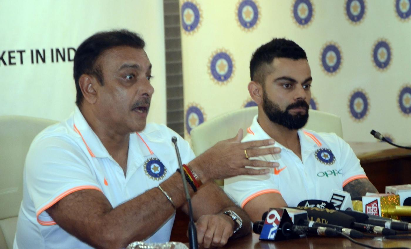 Mumbai: Indian head coach Ravi Shastri accompanied by captain Virat Kohli, addresses a press conference ahead of the team's departure for the tour of Australia; in Mumbai on Nov 15, 2018. India prepares for the challenging tour to Australia, that includes four Tests, three ODIs and as many T20Is. (Photo: IANS) by .