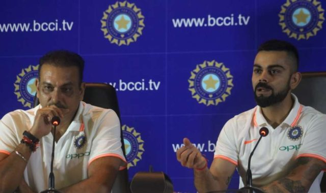 New Delhi: Indian captain Virat Kohli and coach Ravi Shastri address a press conference before leaving for England and Ireland, in New Delhi, on June 22, 2018 (Photo: Bidesh Manna/IANS) by .