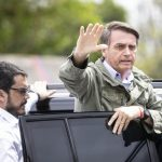 RIO DE JANEIRO, Oct. 28, 2018 (Xinhua) -- Presidential candidate Jair Bolsonaro waves to his supporters as he leaves a polling station in Rio de Janeiro, Brazil, on Oct. 28, 2018. Right-wing candidate Jair Bolsonaro won Brazil's presidential run-off on Sunday. (Xinhua/Li Ming/IANS) by .