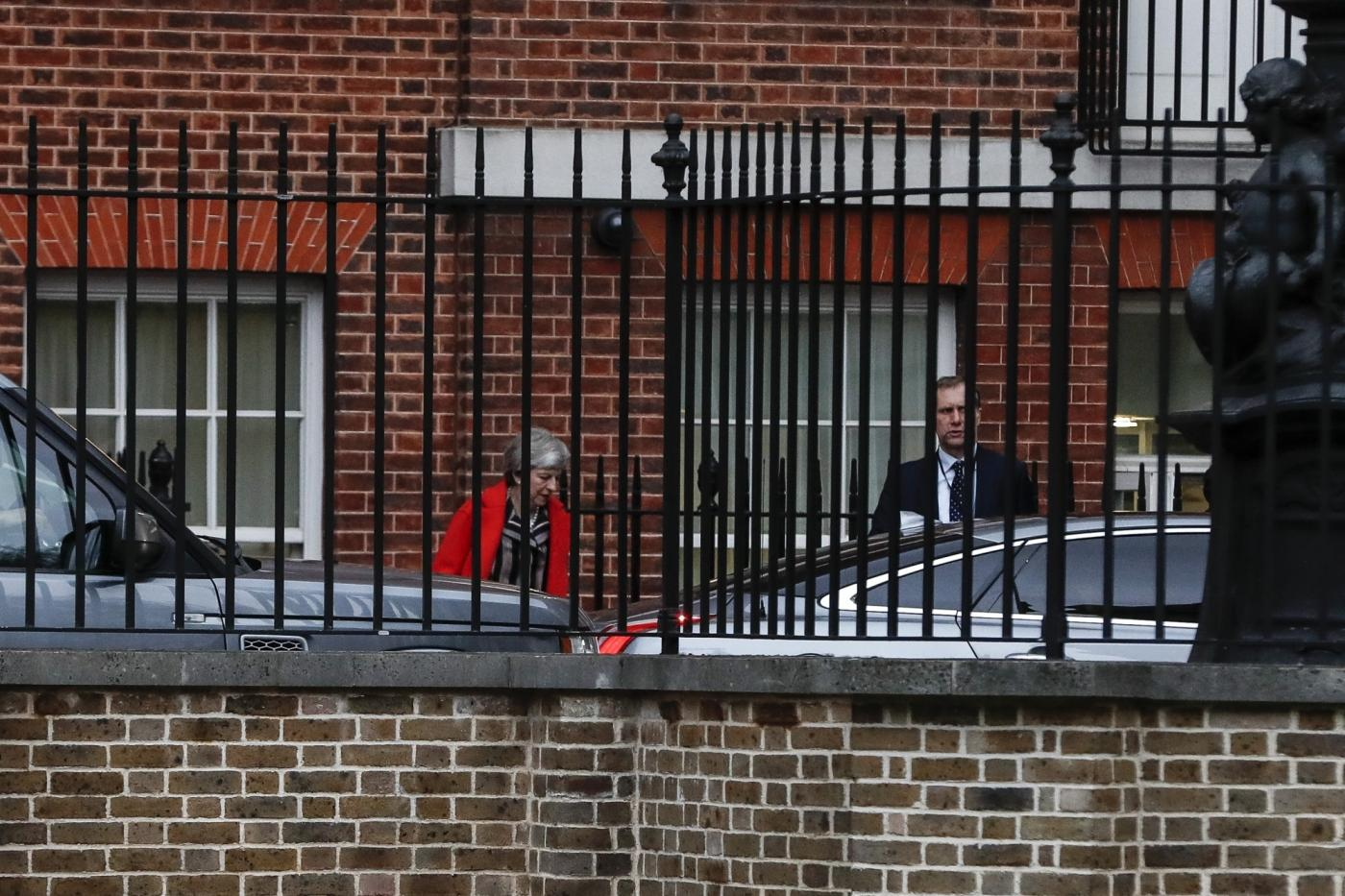 LONDON, Nov. 26, 2018 (Xinhua) -- British Prime Minister Theresa May (L) leaves 10 Downing Street following a cabinet meeting in London, Britain, on Nov. 26, 2018. British parliament vote on Brexit deal will be held on Dec. 11, Theresa May confirmed on Monday. (Xinhua/Han Yan/IANS) by .