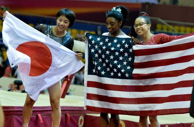 DOHA, Nov. 2, 2018 (Xinhua) -- Gold medalist Simone Biles (C) of the United States, silver medalist Murakami Mai (L) of Japan and bronze medalist Morgan Hurd (R) of the United States celebrate after the Women's All-Around Final at the 2018 FIG Artistic Gymnastics World Championships in Doha, capital of Qatar, Nov. 1, 2018. (Xinhua/Nikku/IANS) by .