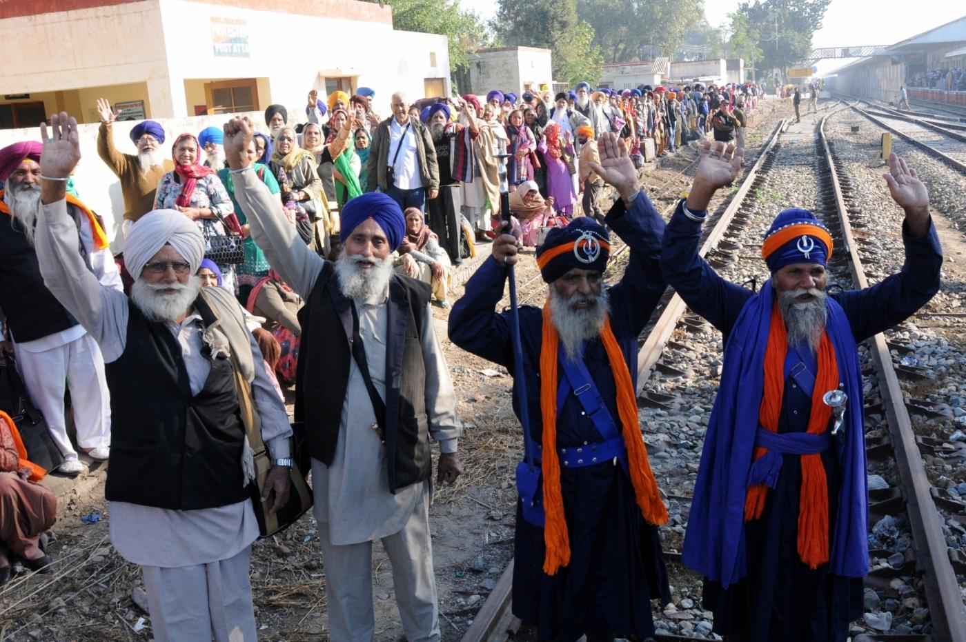 Amritsar: Sikh pilgrims arrive at Attari railway station as they prepare to leave for Pakistan to participate in the birth anniversary celebrations of 1st Sikh Guru, Guru Nanak Dev to be held at Gurdwara Nankana Sahib, on Nov 21, 2018. (Photo: IANS) by .