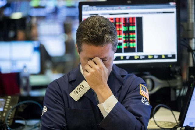 NEW YORK, Oct. 11, 2018 (Xinhua) -- A trader reacts at the New York Stock Exchange in New York, the United States, on Oct. 11, 2018. U.S. stocks extended deep losses in volatile trading on Thursday. The Dow Jones Industrial Average fell 545.91 points, or 2.13 percent, to 25,052.83. The S&P 500 was down 57.31 points, or 2.06 percent, to 2,728.37. The Nasdaq Composite Index was down 92.99 points, or 1.25 percent, to 7,329.06. (Xinhua/Wang Ying/IANS) by .