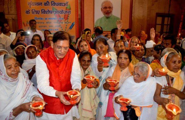 Vrindavan: Sulabh International Founder Bindeshwar Pathak with widows during a programme organised to celebrate Diwali, at Gopinath temple in Vrindavan, Uttar Pradesh on Nov 4, 2018. (Photo: IANS) by .