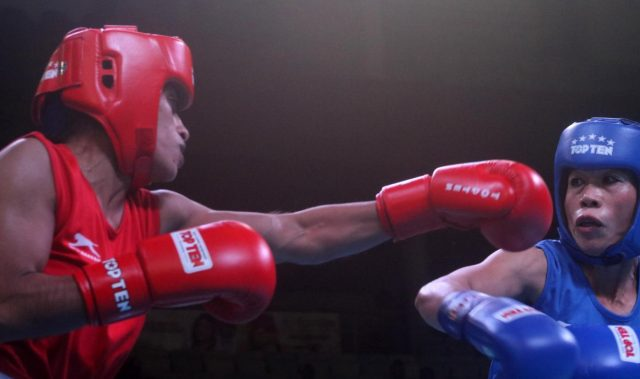 New Delhi: Choudhary Varsha (Red) and M C Mary Kom (Blue) of India in action during the 1st India Open international boxing tournament in New Delhi, on Jan 28, 2018. (Photo: Bidesh Manna/IANS) by .
