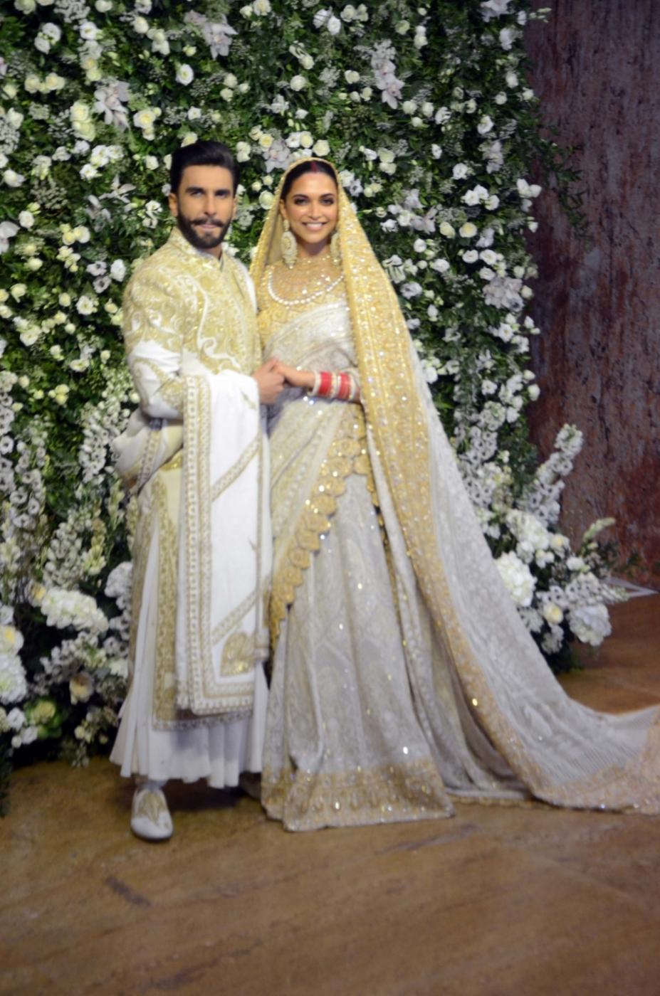 Mumbai: The newlywed actors Deepika Padukone and Ranveer Singh at their wedding reception at Grand Hyatt in Mumbai on Nov 28, 2018. (Photo: IANS) by .