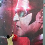 """Chennai: A Rajinikanth fan washes the """"2.0"""" film poster as he celebrates the release of the film in Chennai, on Nov 29, 2018. (Photo: IANS) by ."""